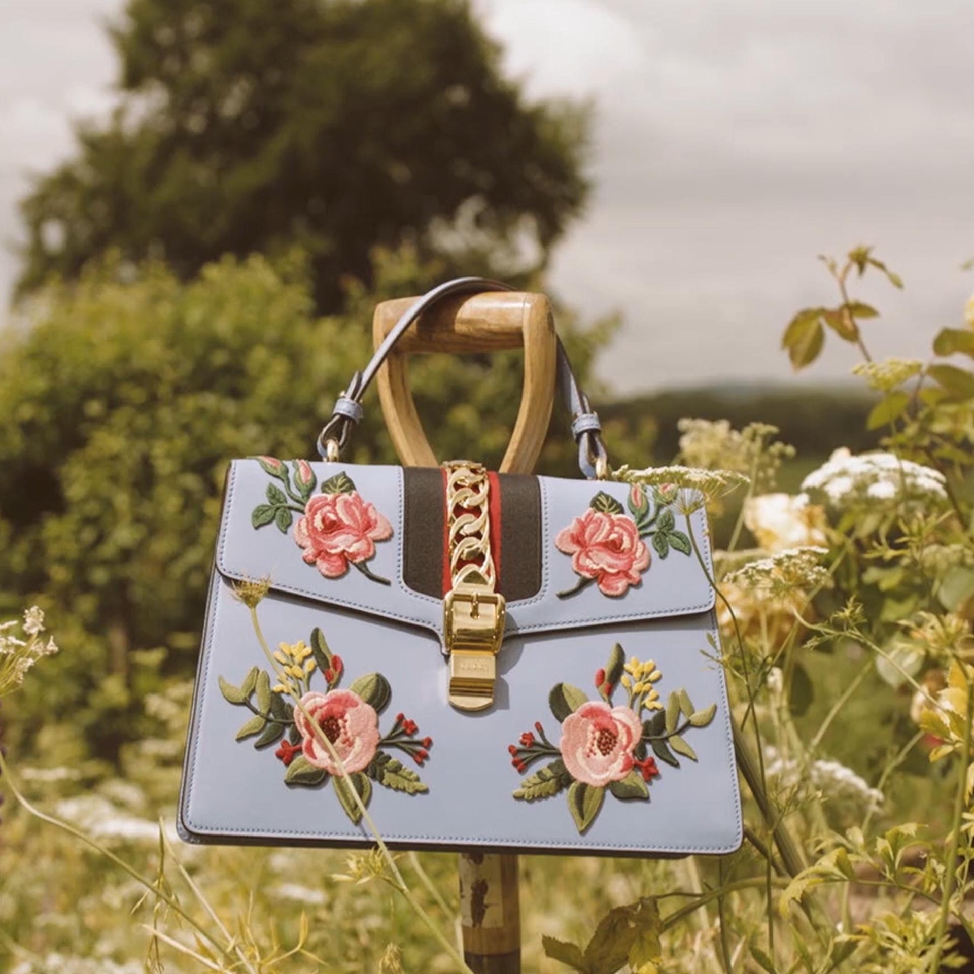 Photo of Gucci handbag in open field